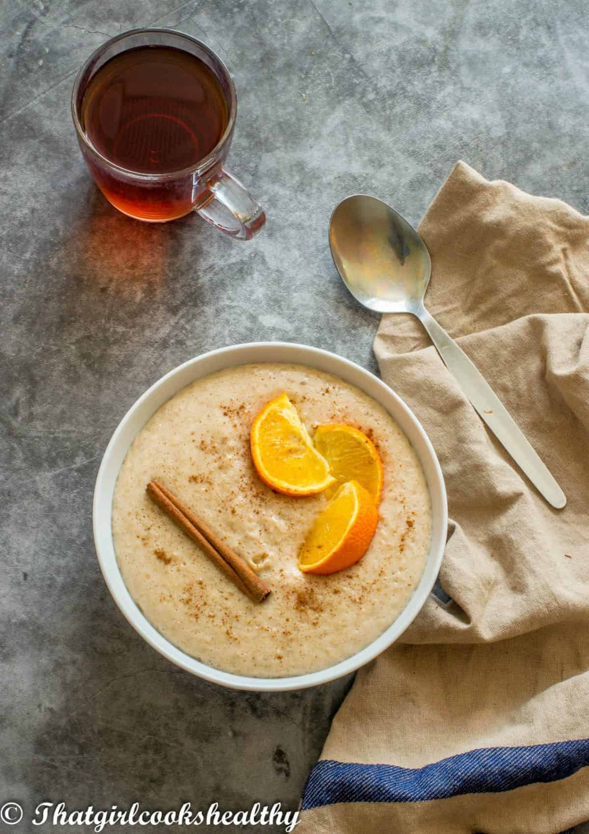 porridge with tea and spoon