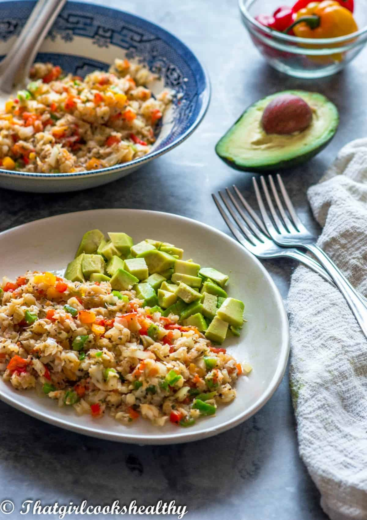 saltfish with avocado on a plate