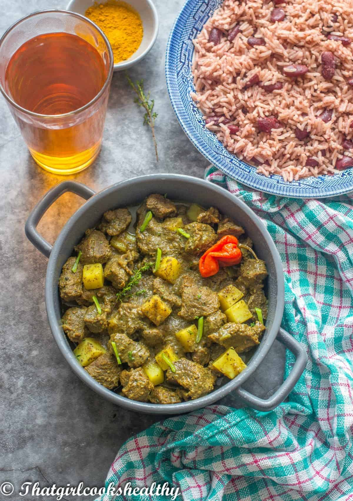 curry goat in scotch bonnet and green garnish