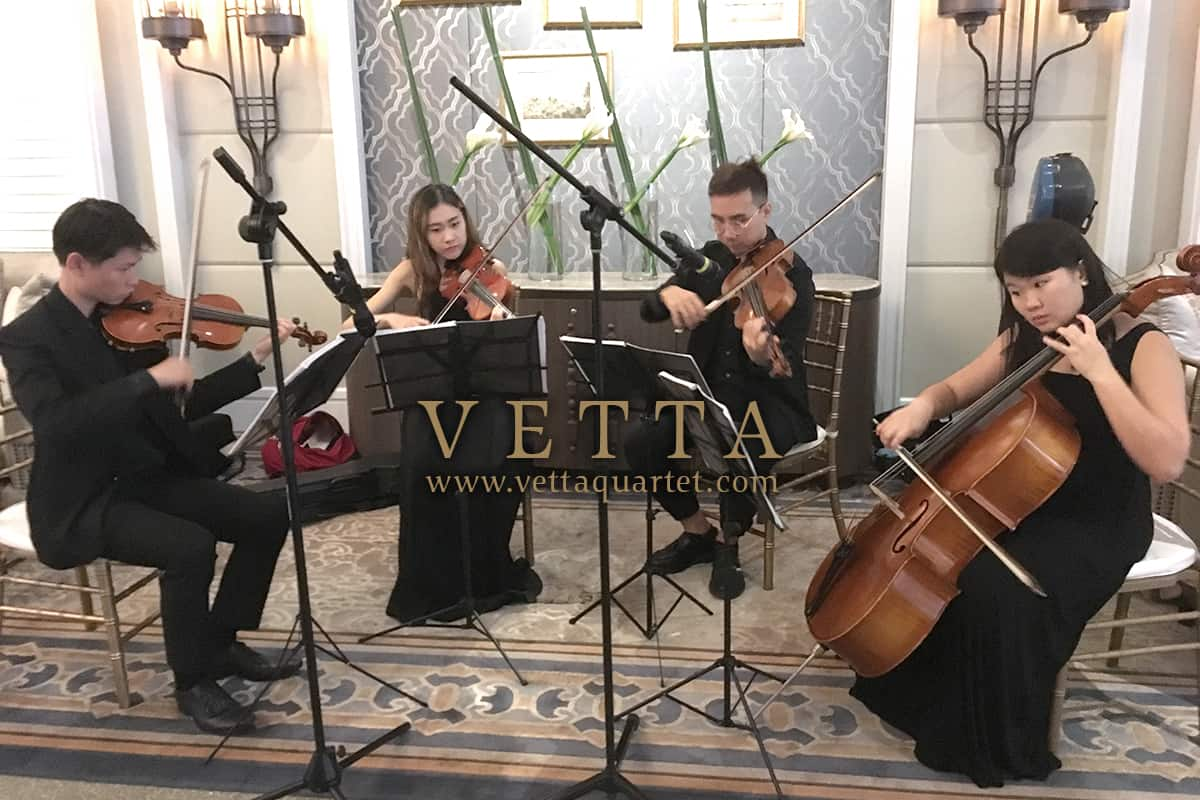 Live String Quartet playing music for wedding at Clifford Pier