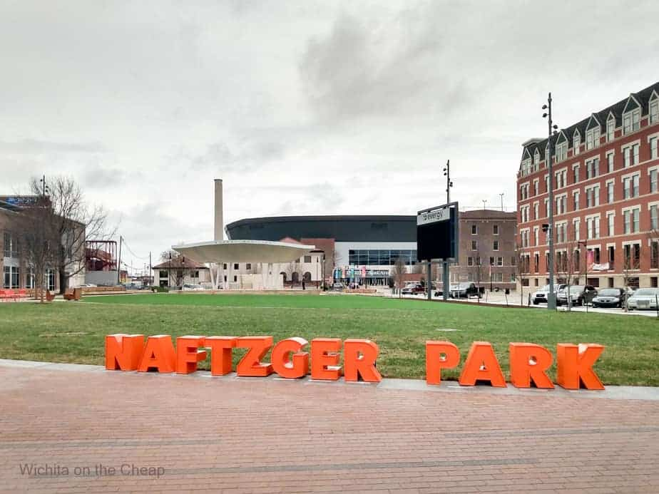 Naftzger Park letters lining the curved edge of the green mall area of the park downtown in Wichita