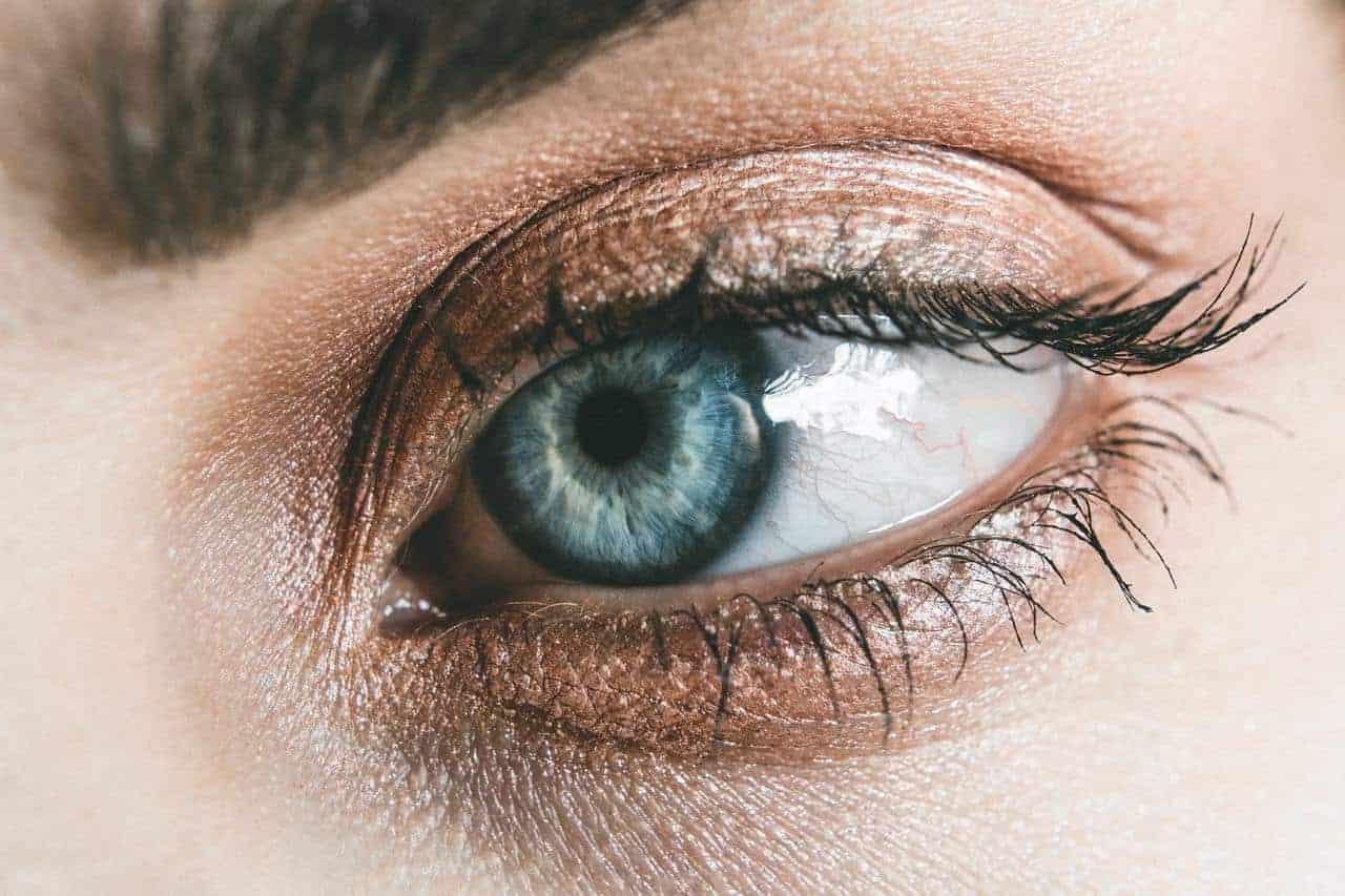 zoom-in on a big blue eye with bronze eyeshadow