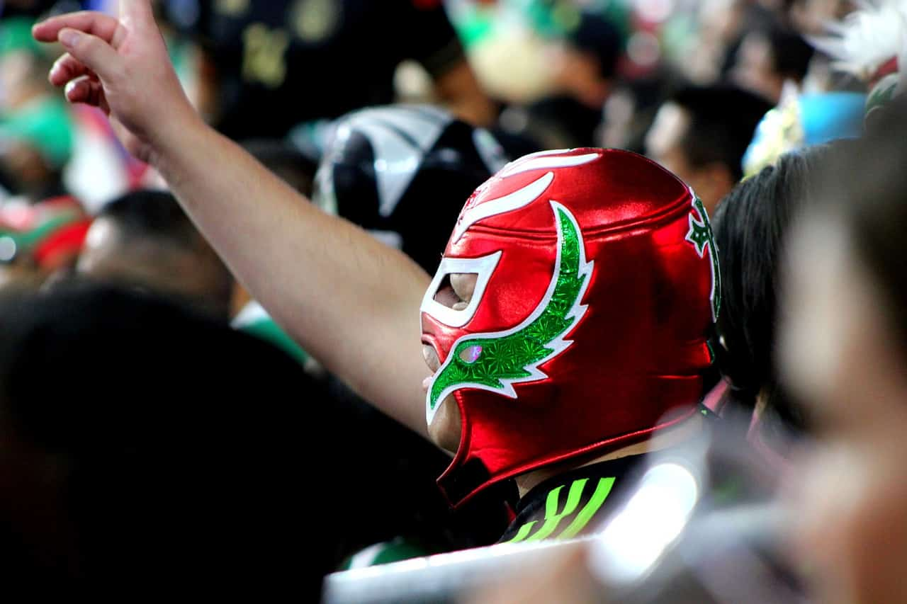 Man wearing a colorful Mexican wrestling mask