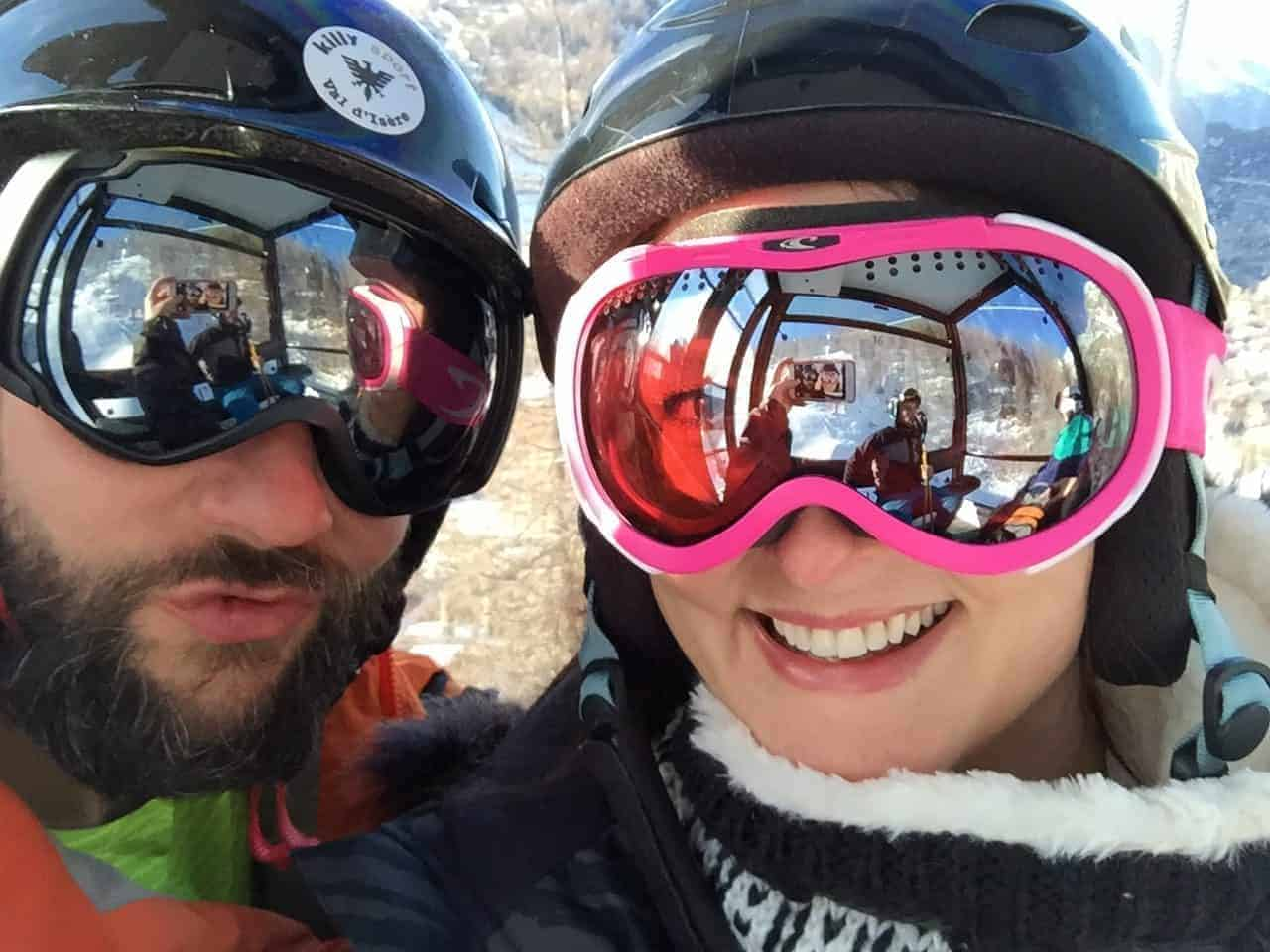 Couple on a ski holiday wearing ski goggles
