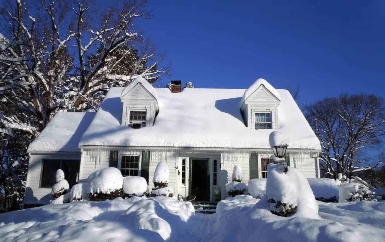 snow covered home in need of exterior painting