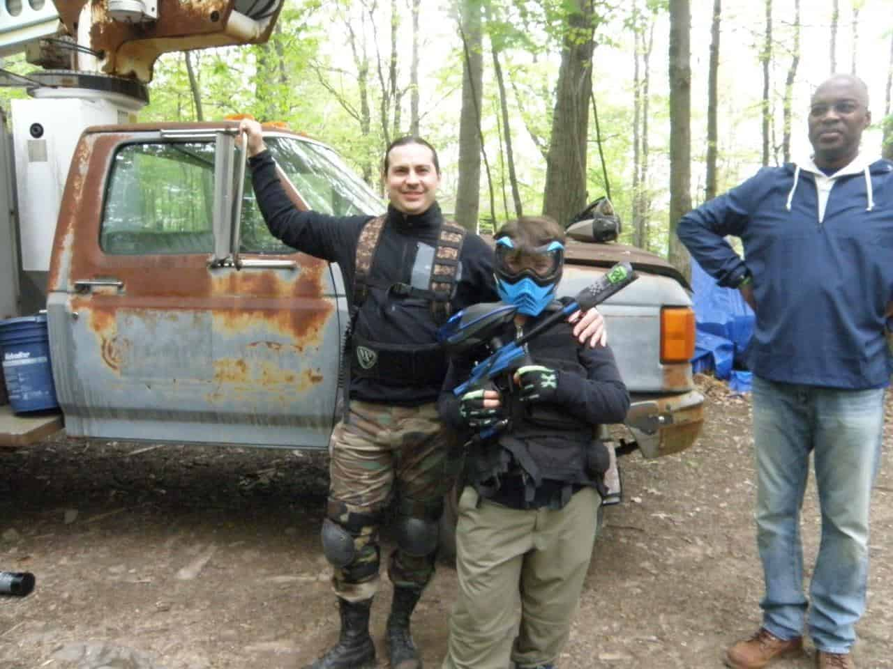 Three men in paintball gear