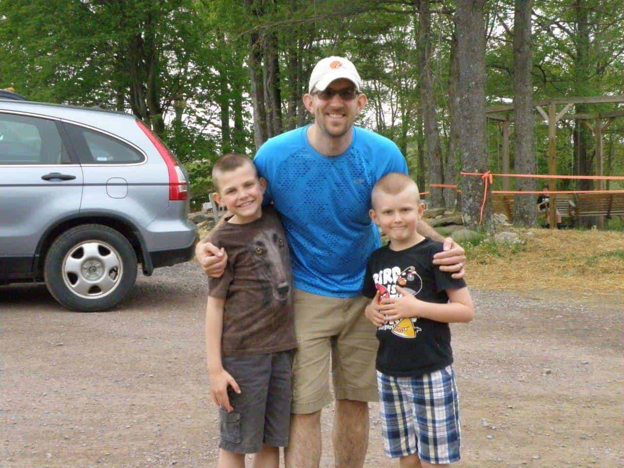Father and sons at camp