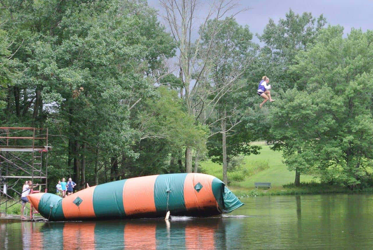 Campers playing on the Blob on the lake