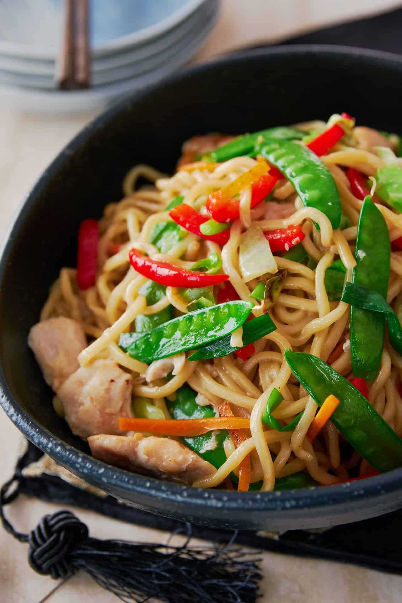 With big chunks of juicy chicken and a rainbow medley of vegetables this Chicken Chow Mein makes for a deliciously balanced one pan meal.