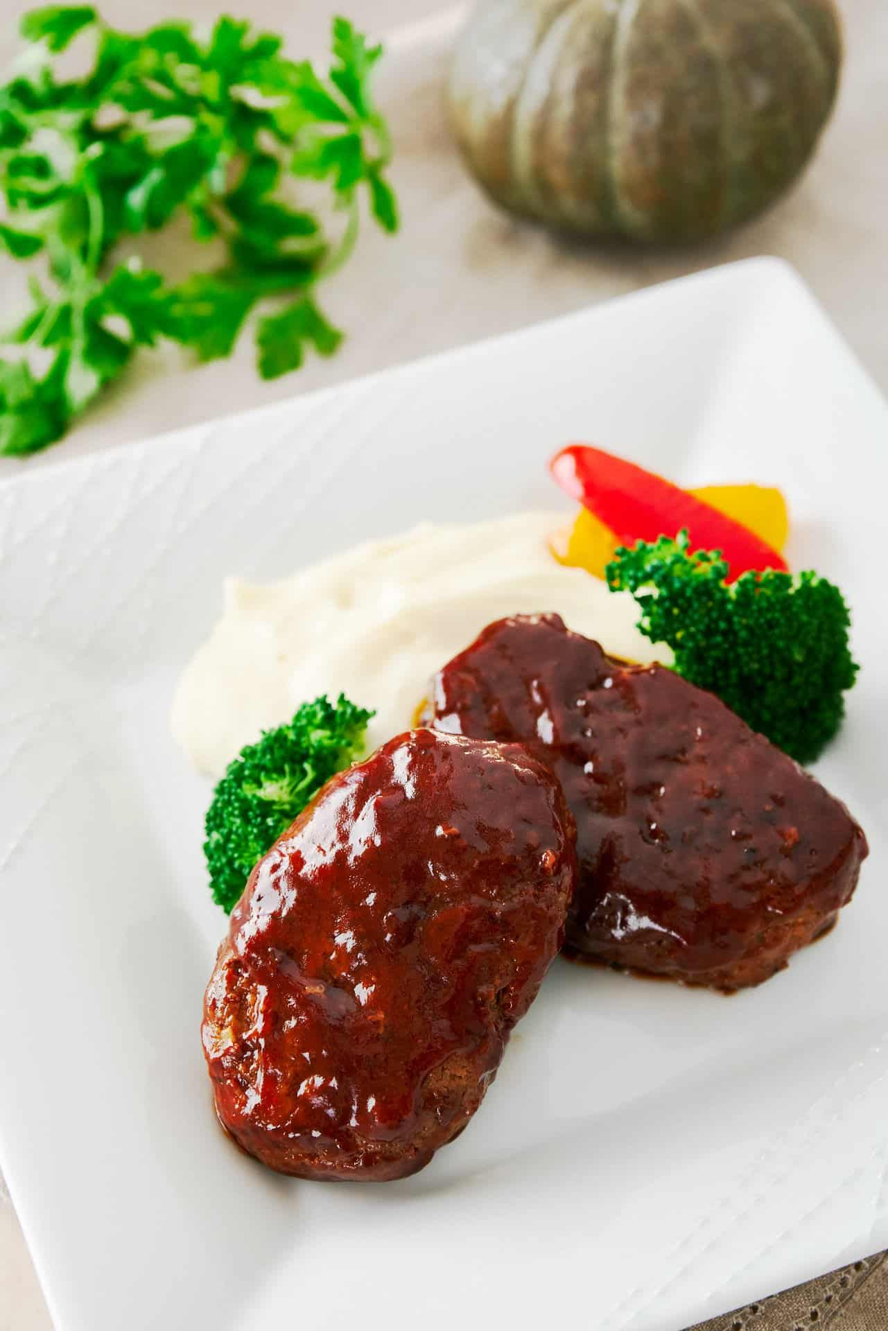 Hamburg Steak is like a single serving meatloaf. With big juicy patties glazed in a sweet and savory sauce, this is one of the most popular home cooked meals in Japan.