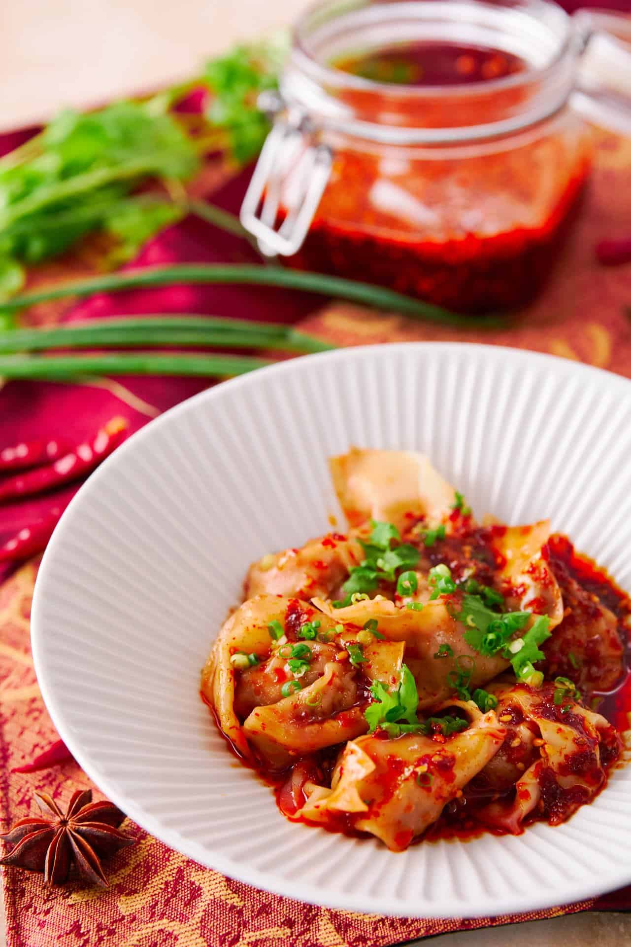 With tender pork dumplings wrapped in a slick noodle and tossed with a fiery Sichuan-style sauce, these Spicy Wontons in Chili Oil are easy to make and delicious!.