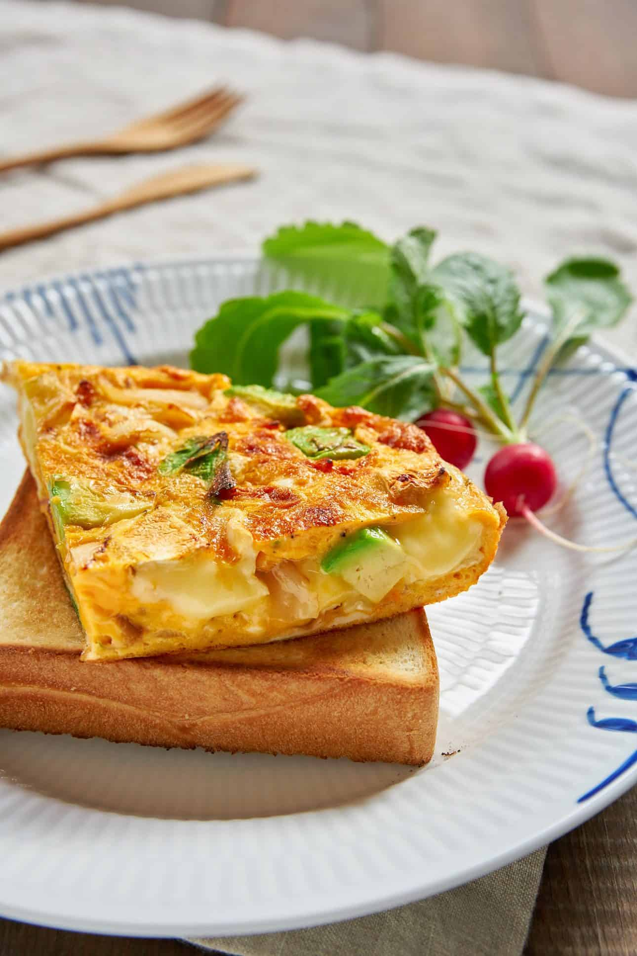 Pools of molten camembert cheese make this 15 minute avocado and caramelized onion frittata ridiculously good.