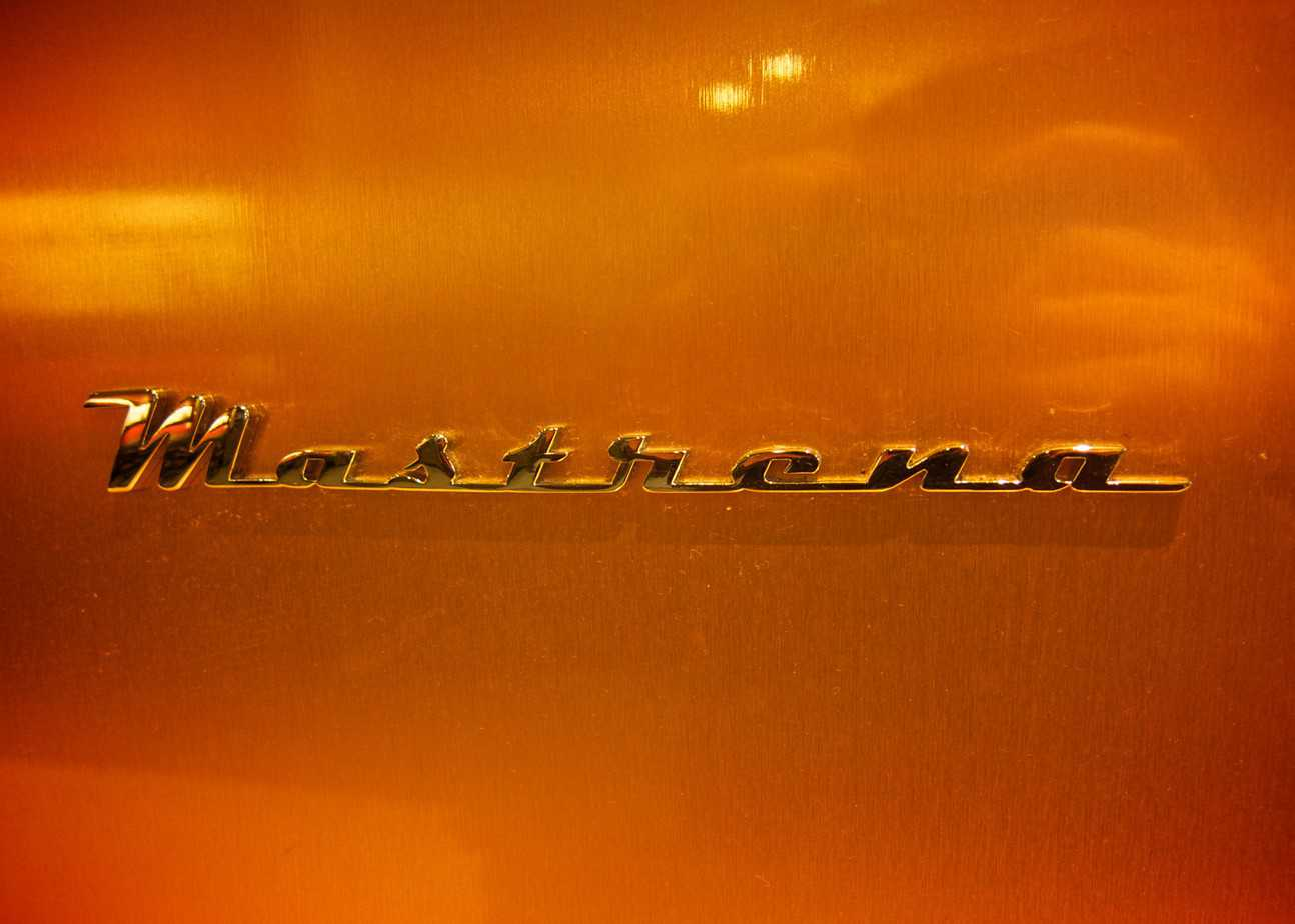 The Mastrena logo in raised lettering on the outside of a Mastrena espresso machine at Starbucks