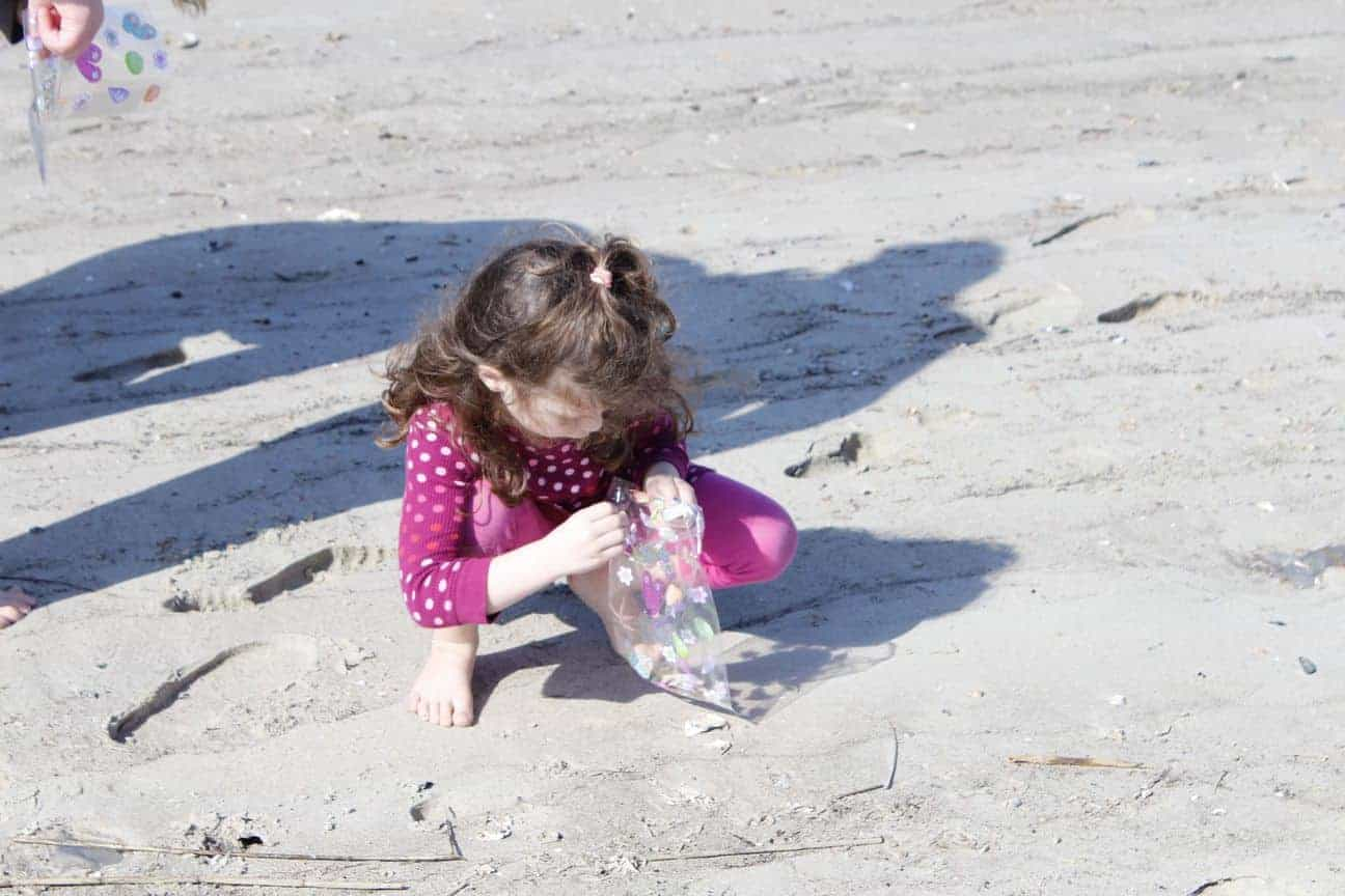Child finding items on the beach. Party boat fishing Charleston, SC