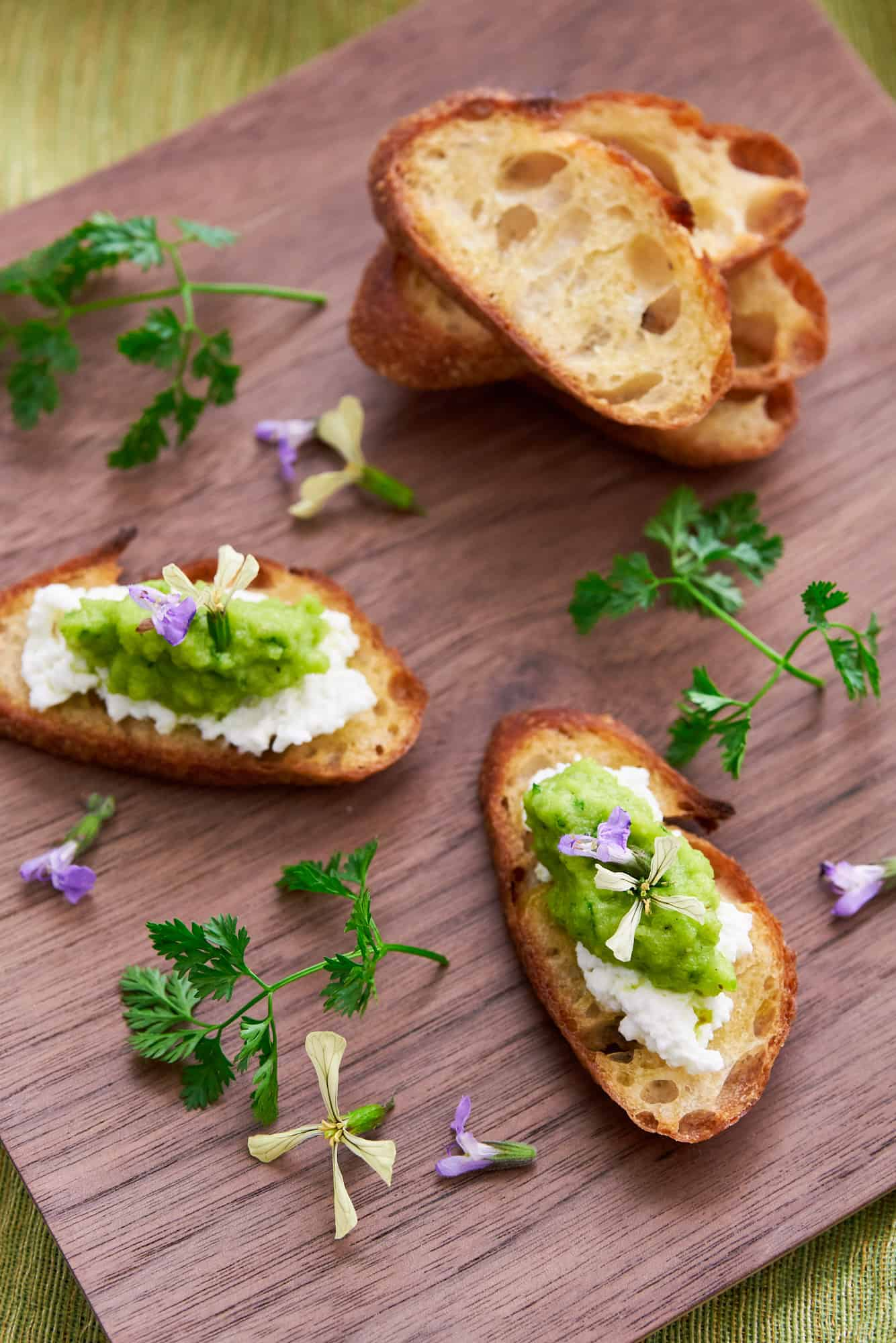 Delicious 5 ingredient Green Pea Pesto Recipe is the perfect spring canape on crostini, spread in sandwiches, or tossed with pasta.