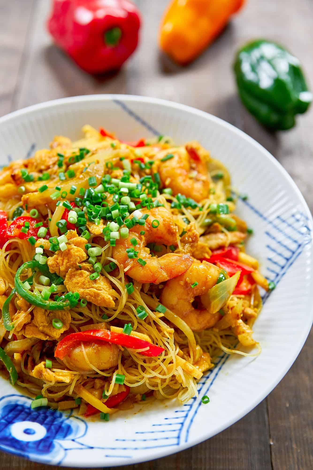 These delicious Singapore Noodles are loaded with shrimp, veggies, and curry flavored rice noodles. Way better than Chinese take-out from a red pagoda box!