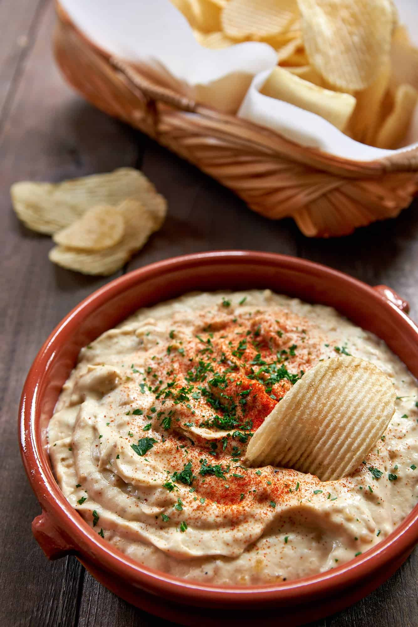"""This guilt-free french Onion dip is made from scratch and loaded with sweet caramelized onions in a tangy cashew """"sour cream"""" #plantbased #dairyfree #dip."""