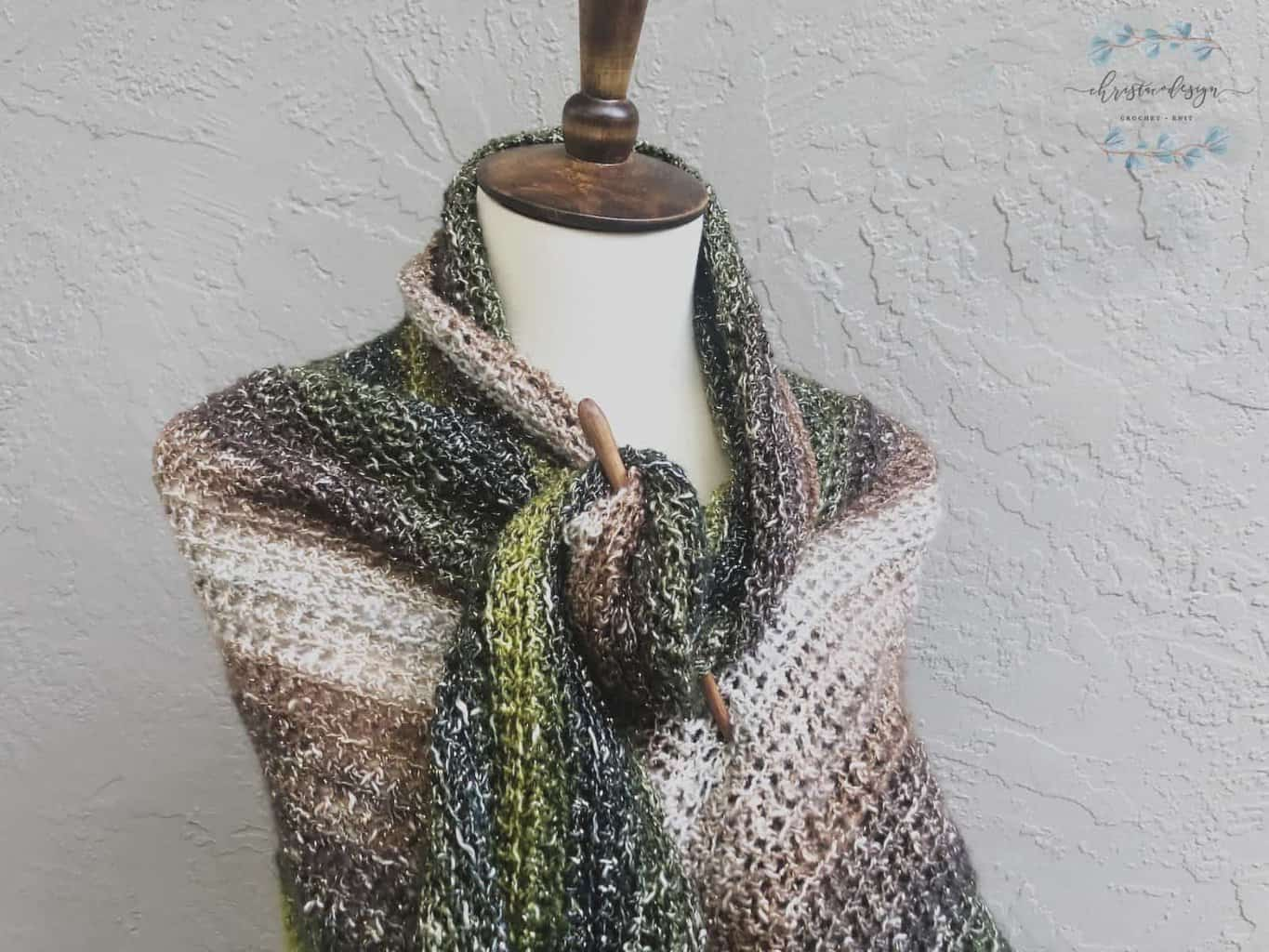 picture of green summer shawl with wood pin
