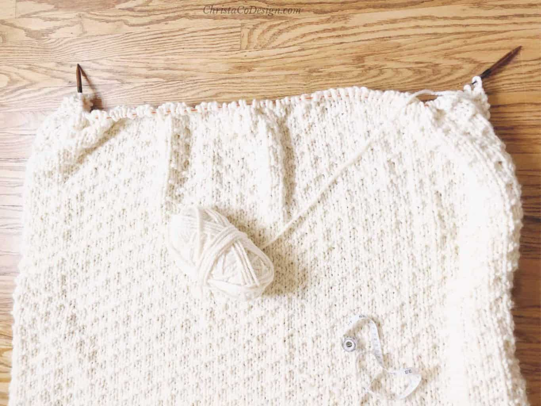 picture of cream Bella vita knit blanket on circular kitting needles