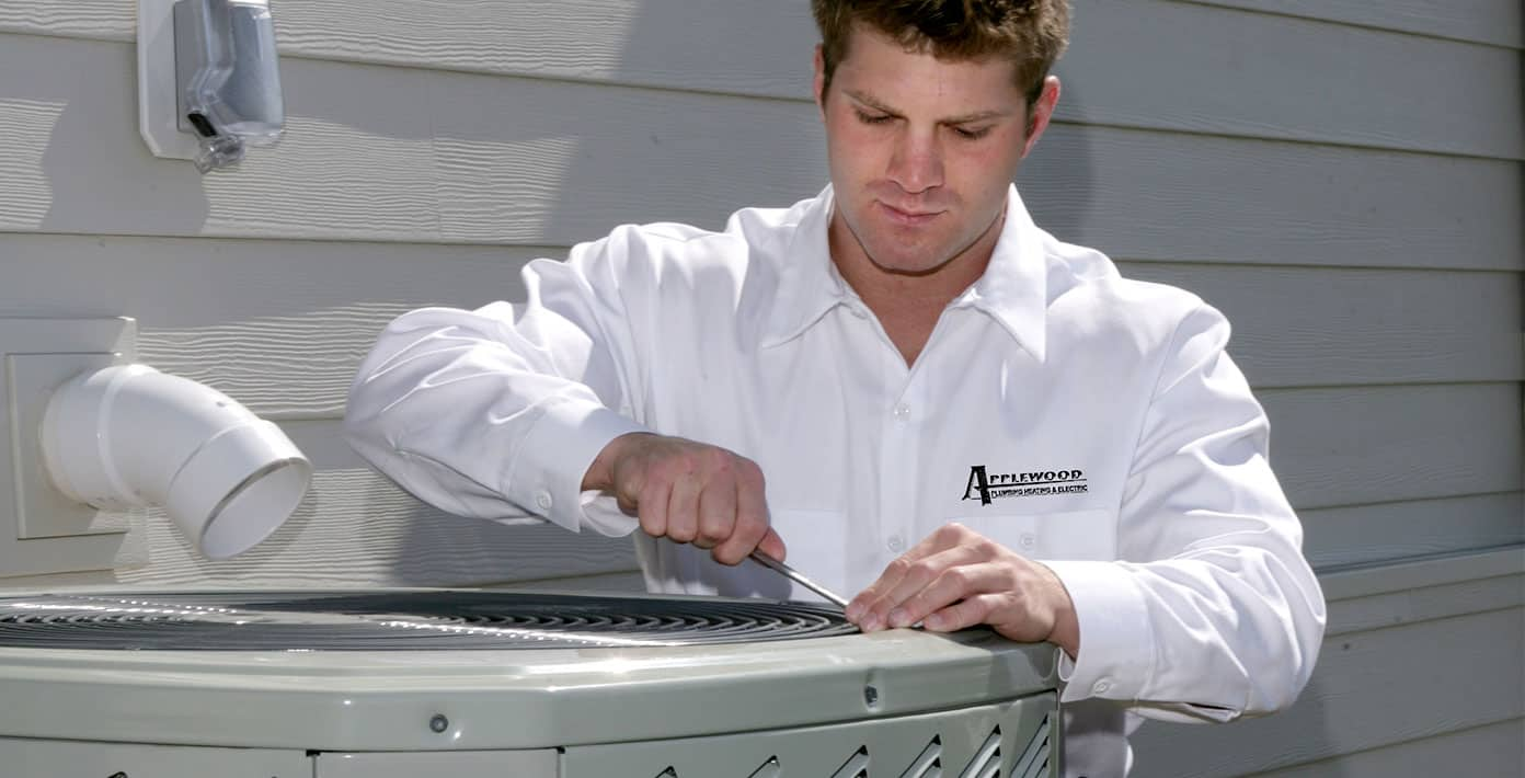 applewood employee fixing air conditioner