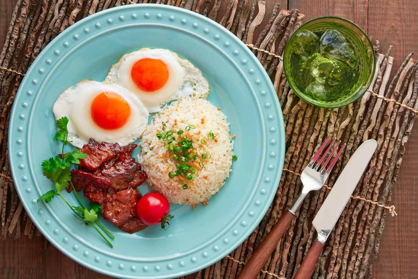The Best Tosilog Recipe, with home-cured Tocino (Filipino Bacon), Sinangag (garlic fried rice), and sunny side up eggs.