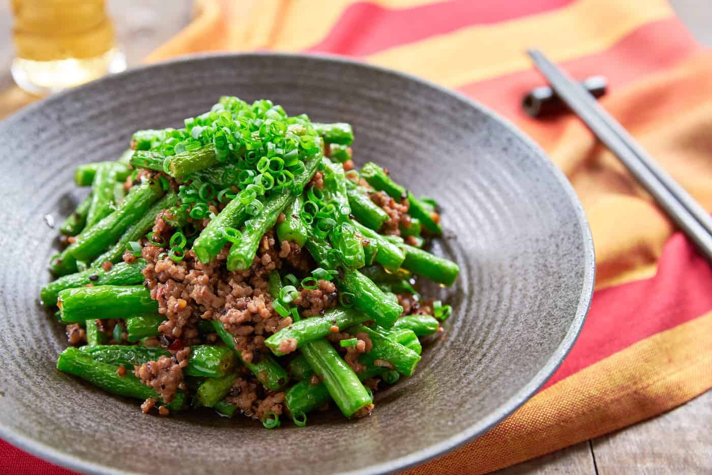 This delicious green bean stir-fry comes together in just mimnutes and yet it's loaded with tender green beans and ground pork seasoend with garlic, black beans and chili paste.