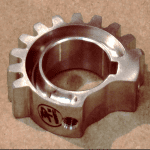 close up of a small metal gear, aviation parts