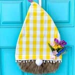 Spring Gnome Door Hanger with yellow and white check material and flowers