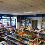 inside view of shop front with aisles of snacks
