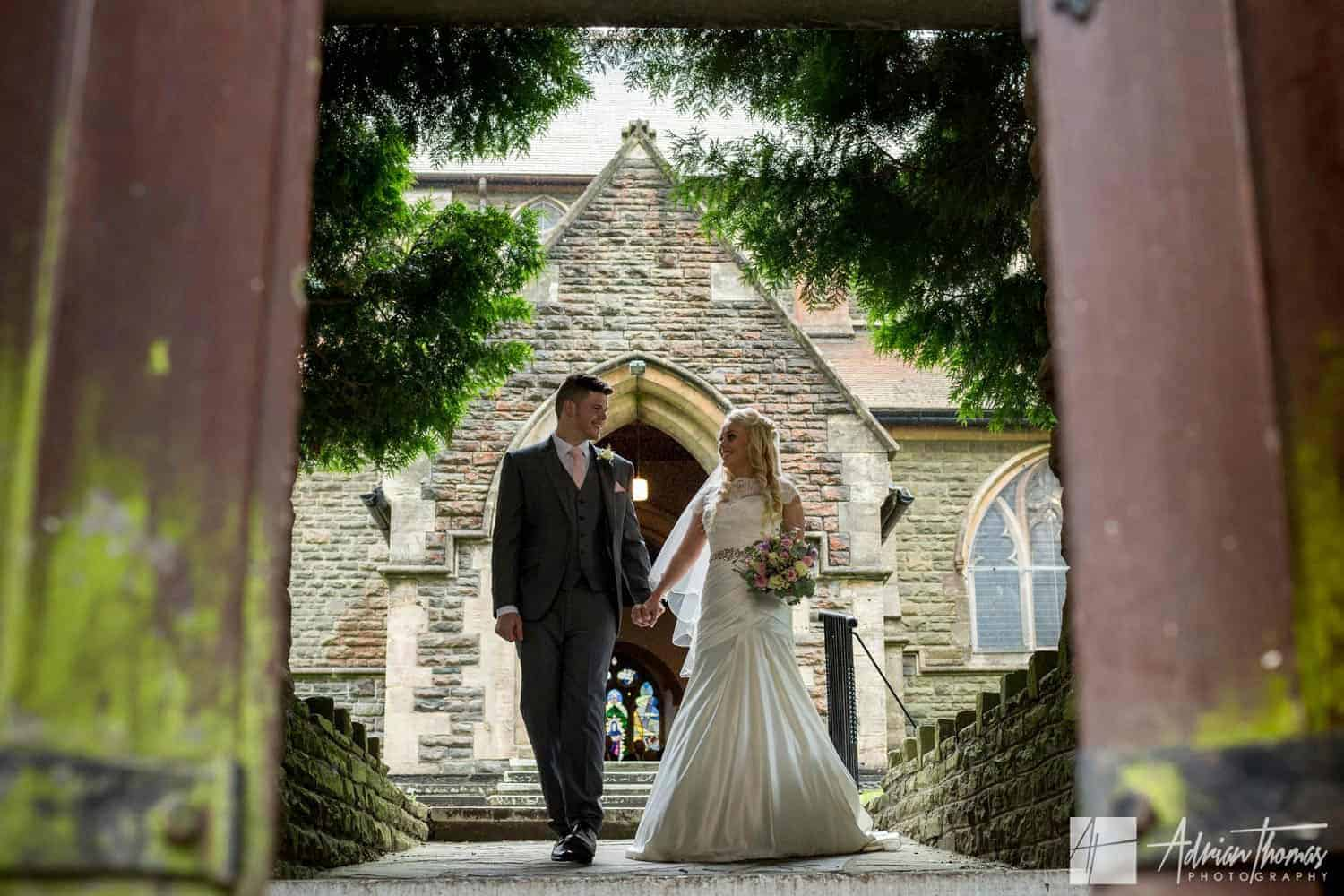 Bride and groom leaving their St Martin's Church Caerphilly wedding.