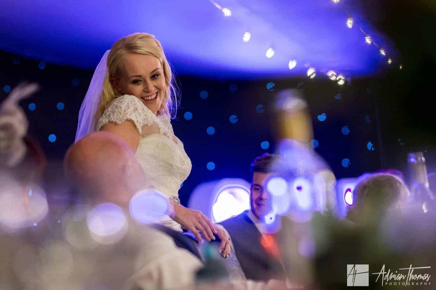 Image of bride talking during speeches at her Maes Manor Hotel wedding reception.