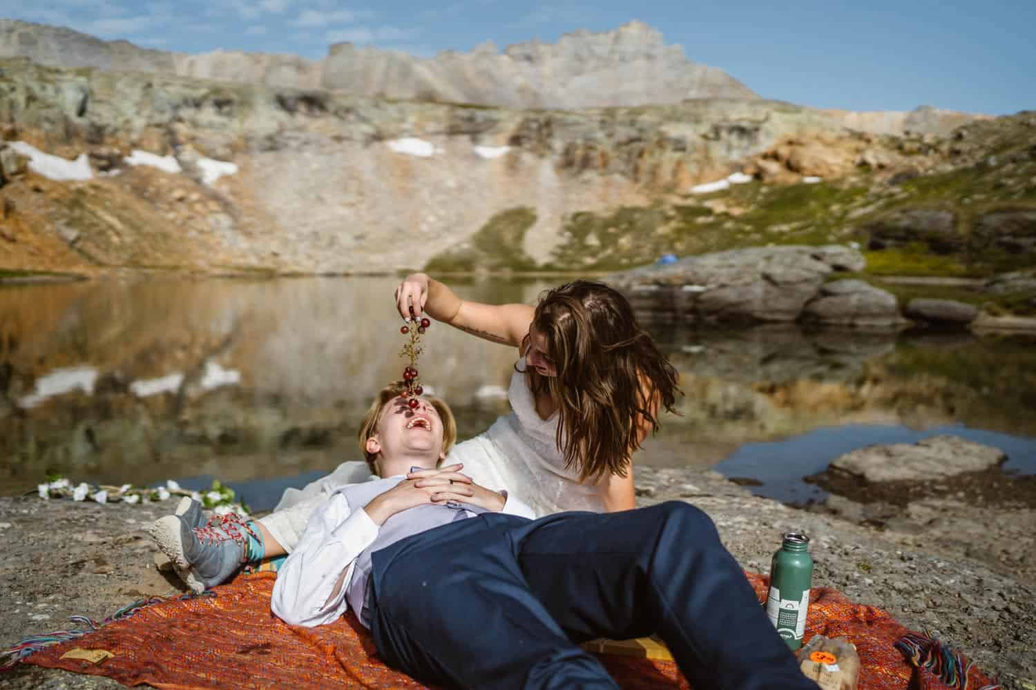 Bride and Groom Eating Ouray Colorado Elopement
