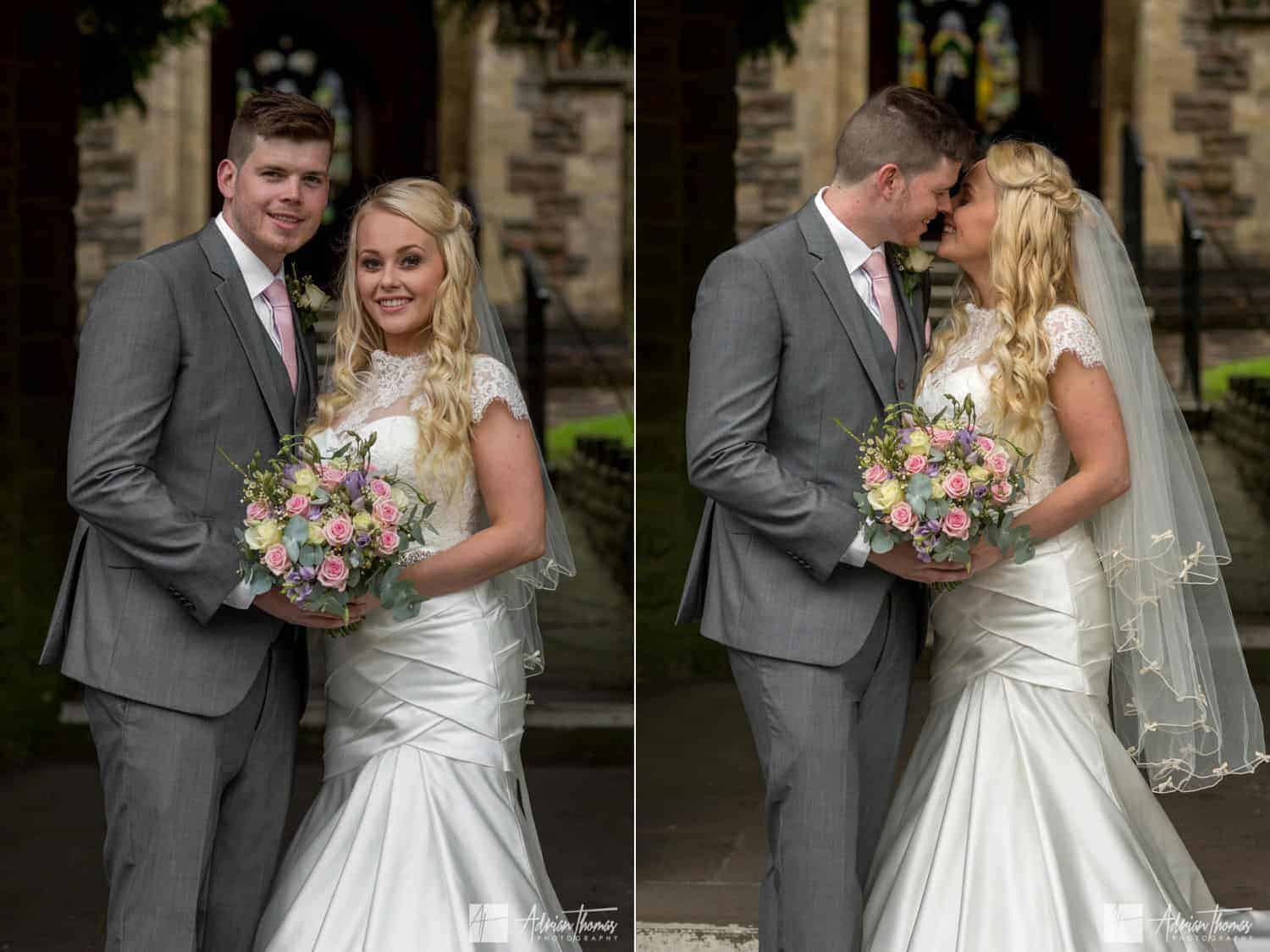 Bride and groom kissing at their St Martin's Church Caerphilly wedding.