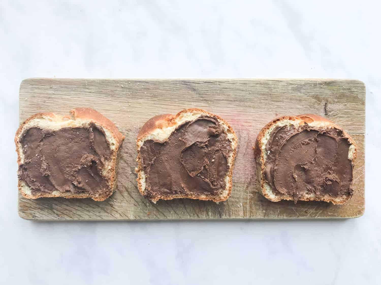 Three slices of brioche bread spread with Nutella