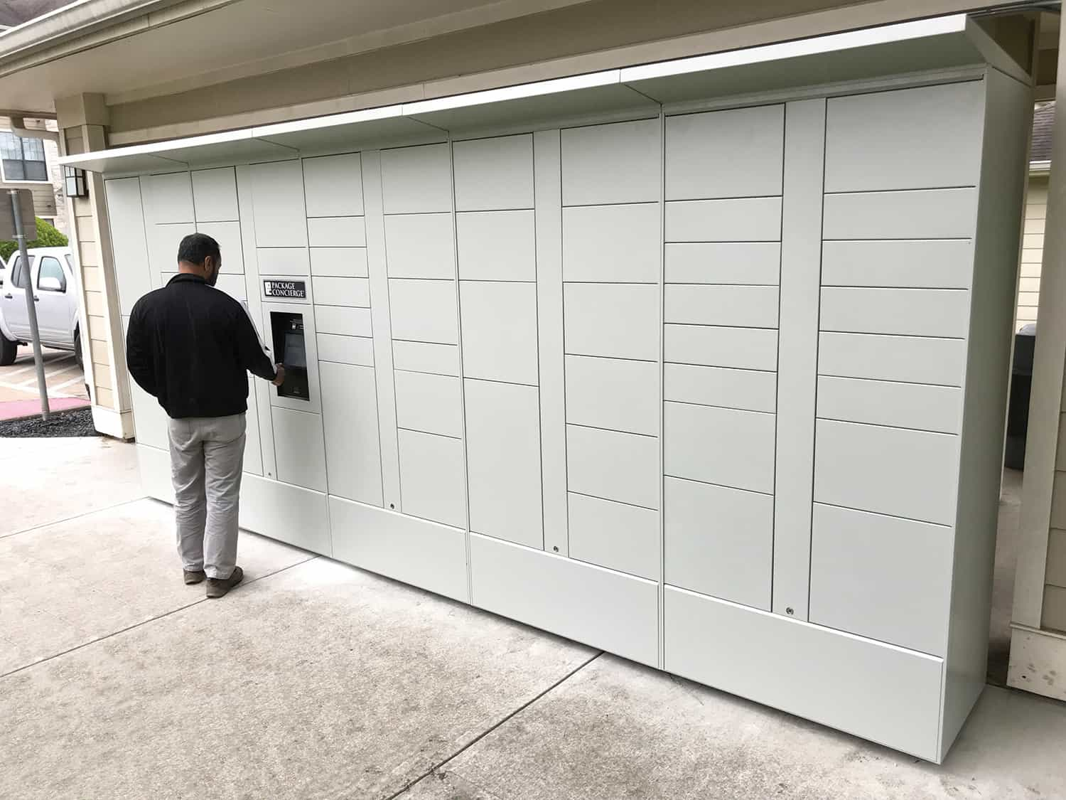 Man accessing outdoor package locker system