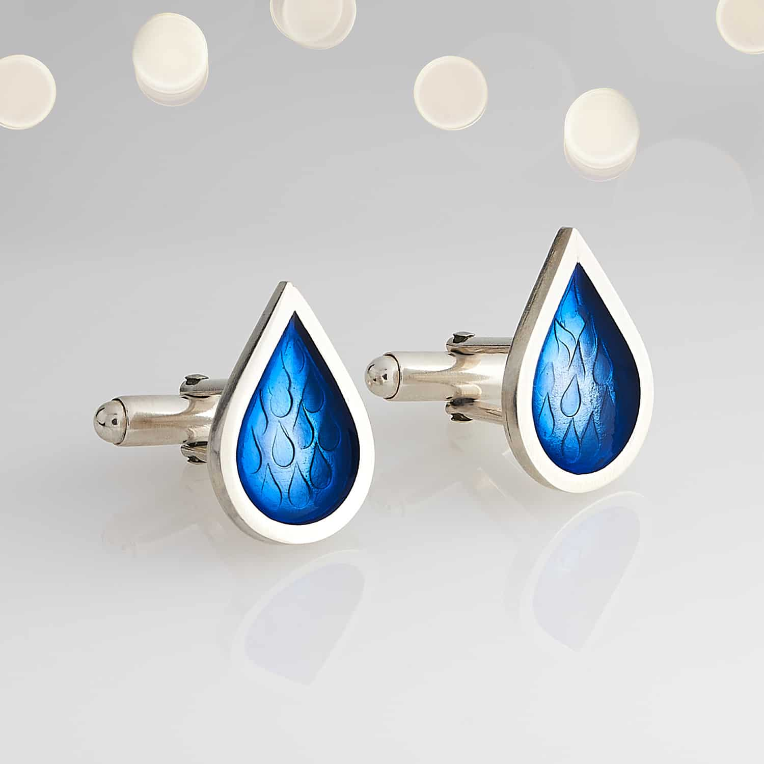 Product photograph of droplet styled cufflinks handmade from silver