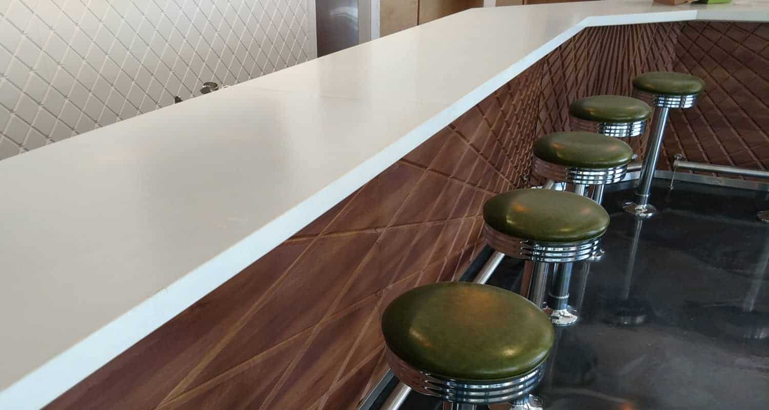 Clean, Modern White Concrete Countertop in a diner in St Petersburg FL