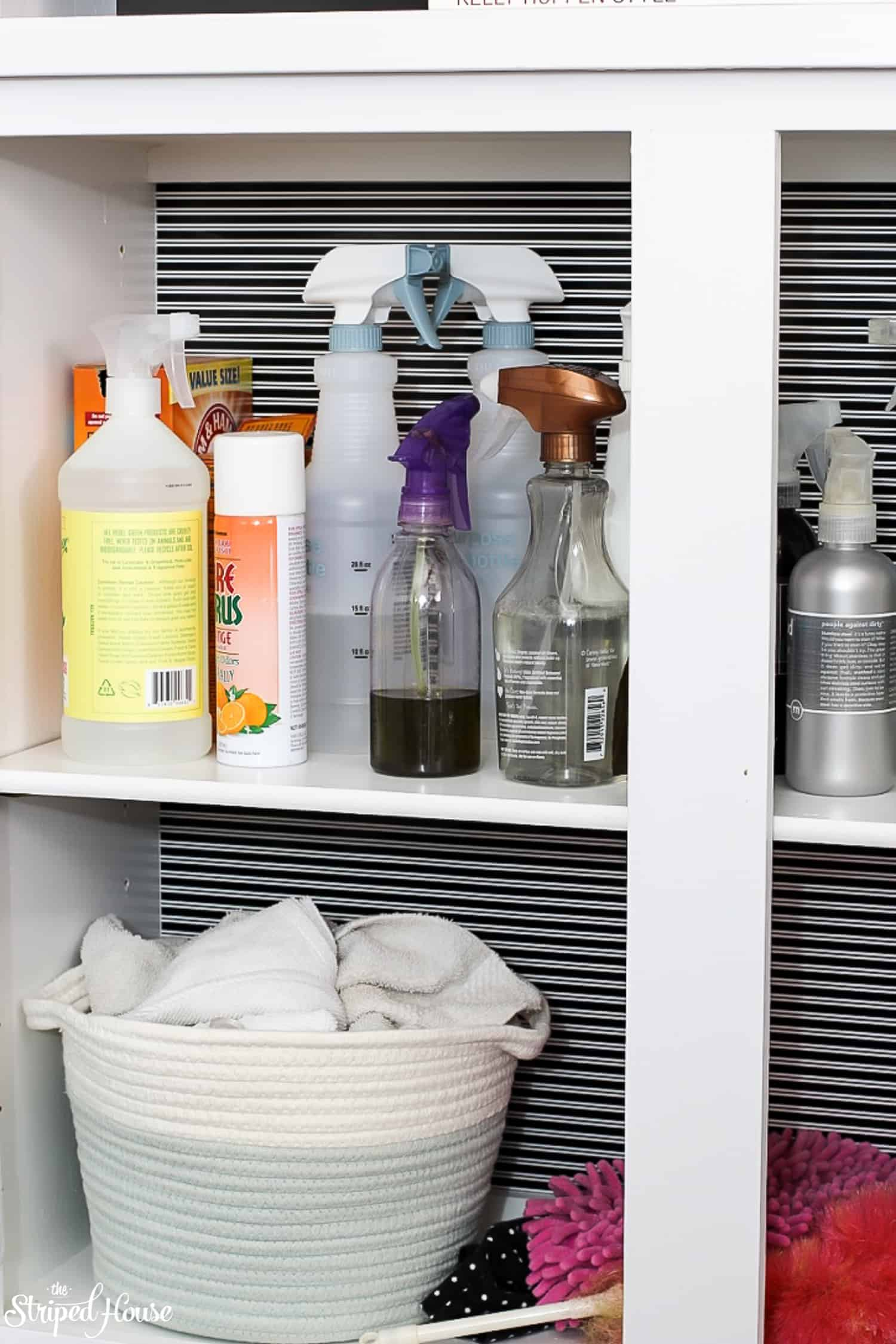 Turning a wasted cabinet into a bright, organized space for cleaning supplies.