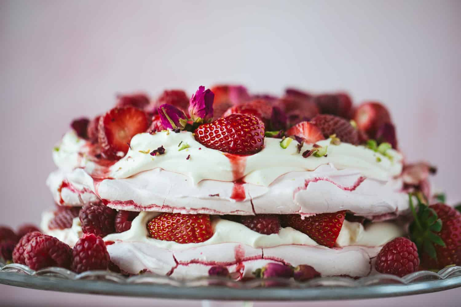 Side view of a summer berry pavlova