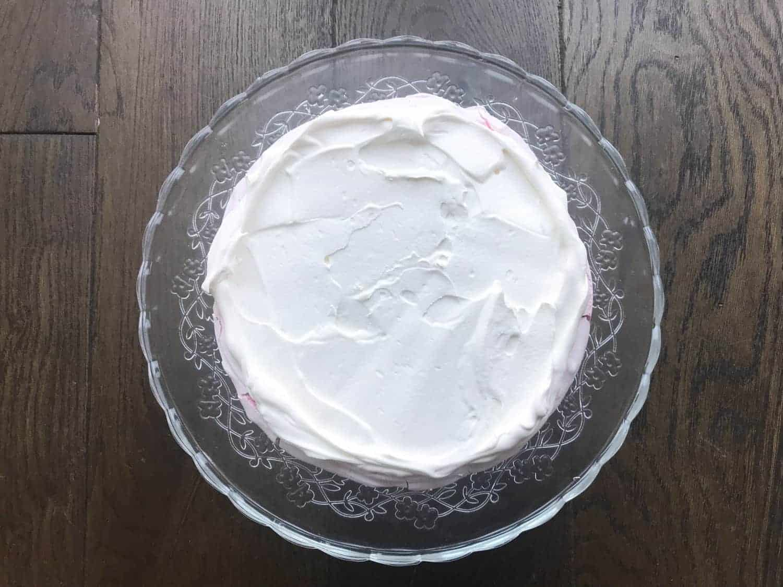 Whipped cream spread onto meringue