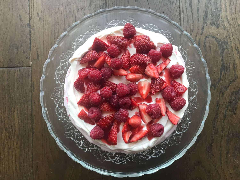 Berries on top of a meringue