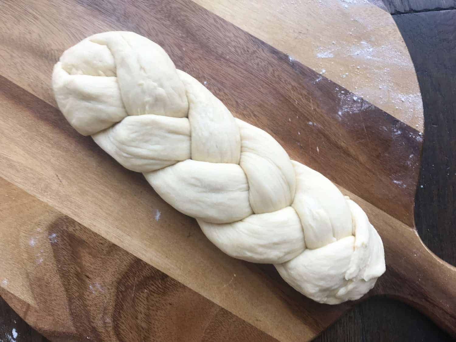 A brioche loaf that has been made into a plait