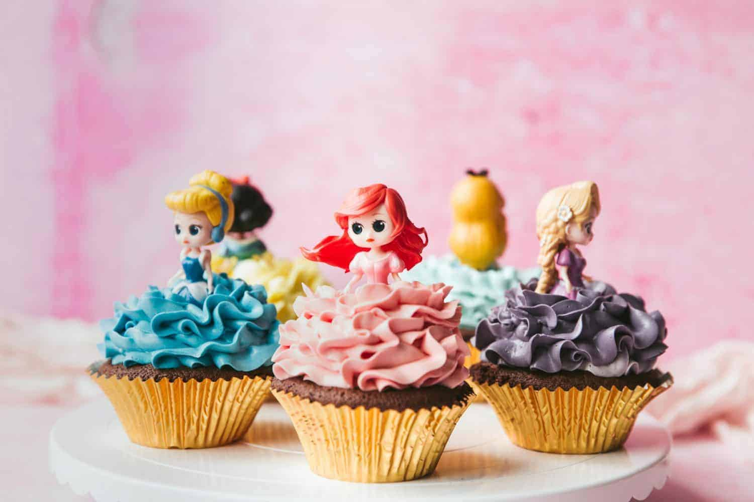 5 Disney Cupcakes with princess cupcake toppers.