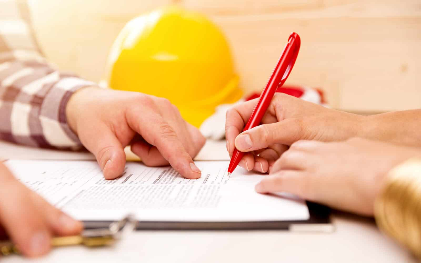 Signing Document With Roofing Adjuster For Insurance Claim