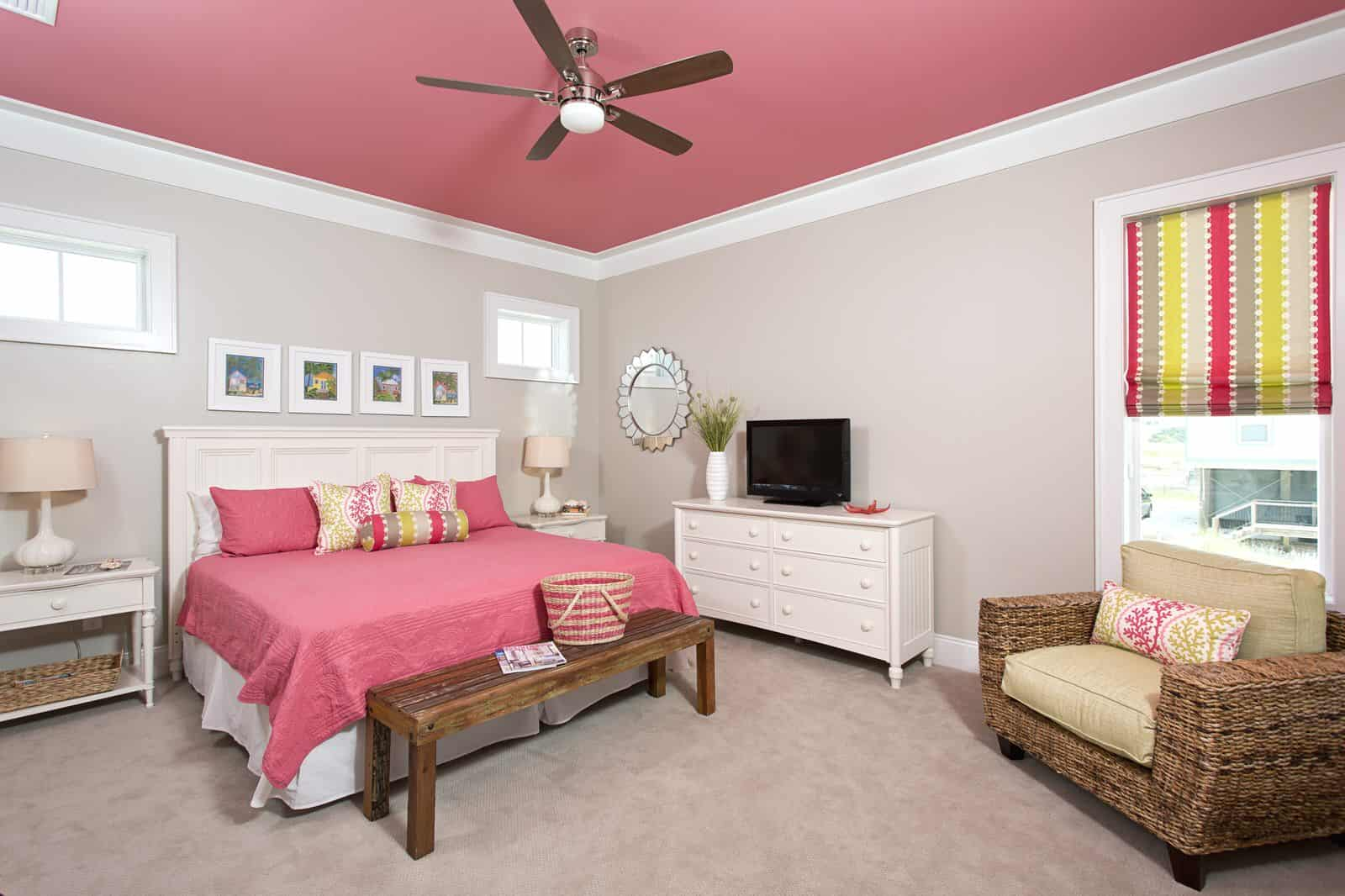 pink and grey bedroom with rogue ceiling