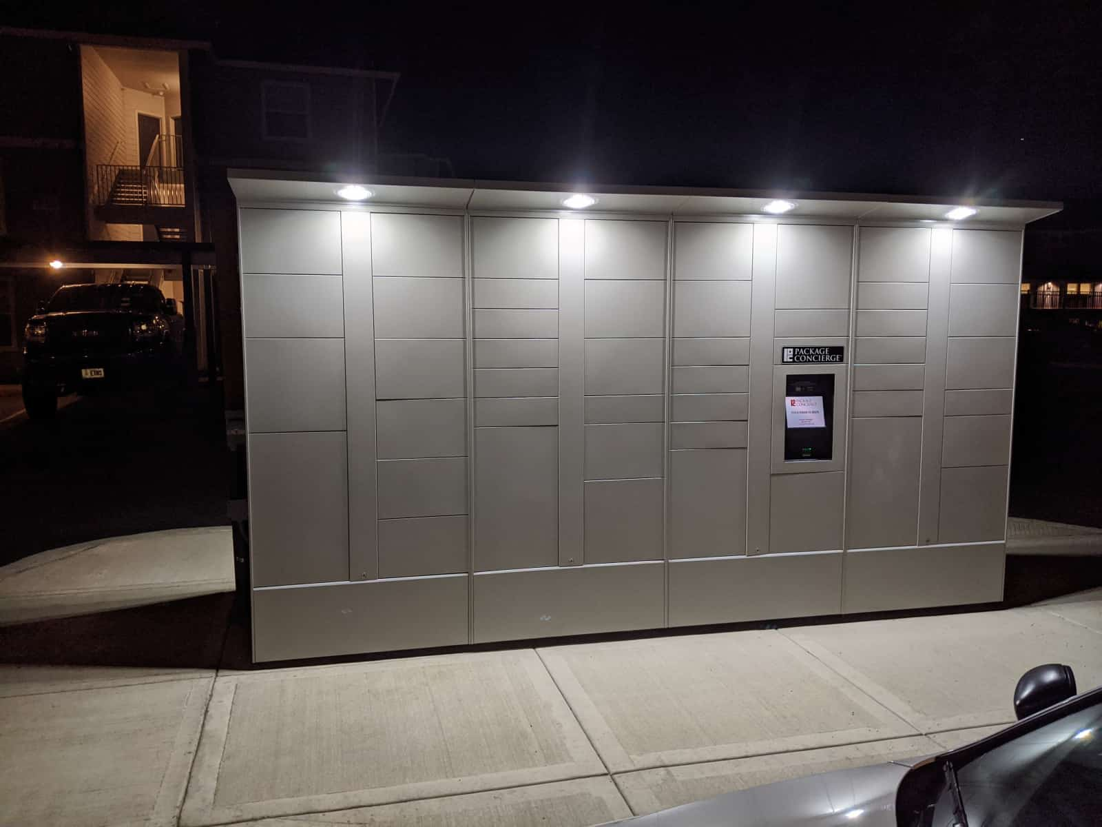 Outdoor Package Locker at Night with LED Light Awning