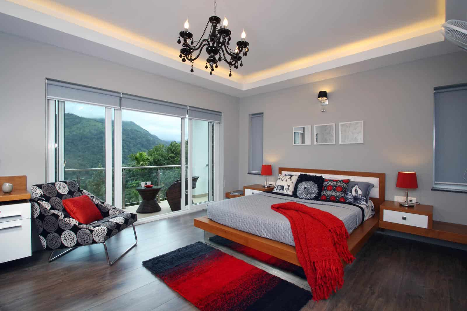 grey bedroom with accentuating red decorations
