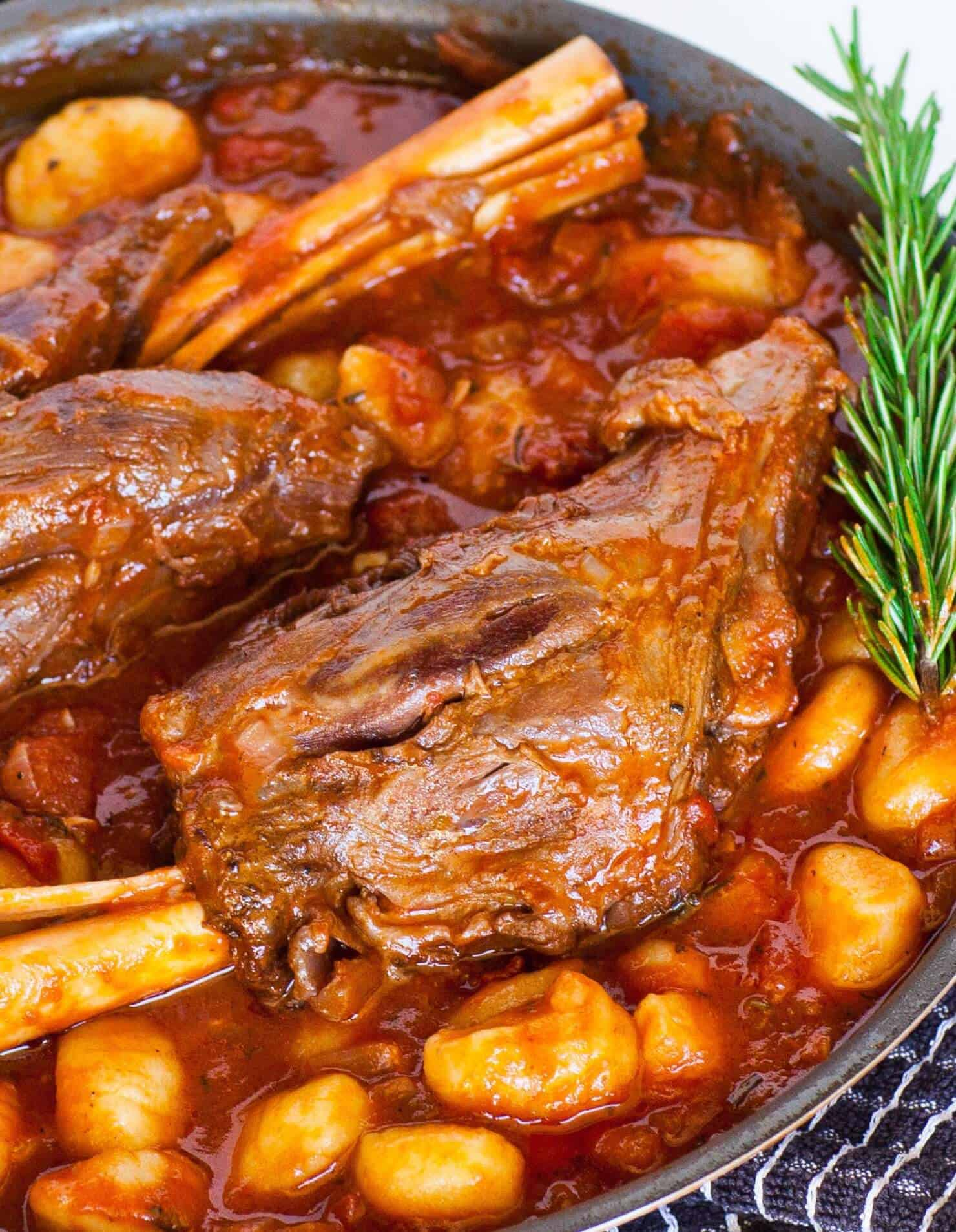 lamb shanks braised in tomato sauce with gnocchi
