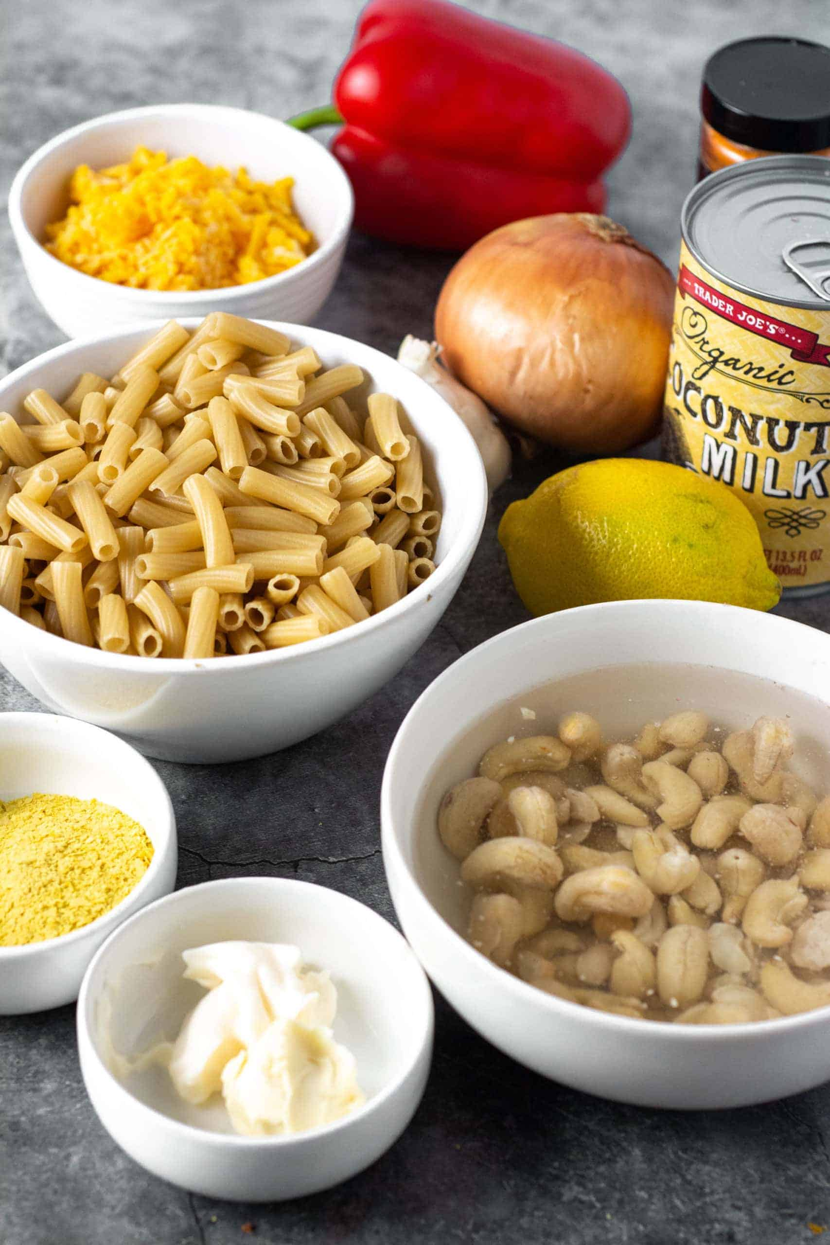 Vegan mac and cheese ingredients on a grey background