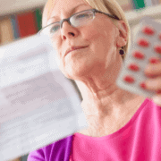 woman reading drug information